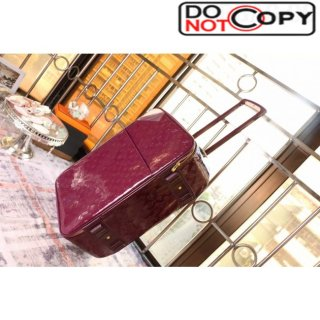 Louis Vuttion Burgundy patent leather wheeled luggage