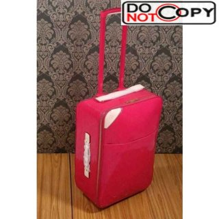 Louis Vuttion Rosy patent leather wheeled luggage